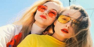 two women in bright sun glasses