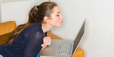 girl flirting with computer