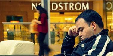 man sleeping at mall