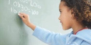 student writing blackboard smart girl