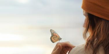 woman with butterfly on hand