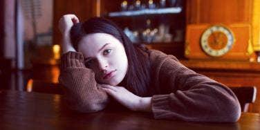 sad woman at the table