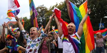 pride parade photo, young people with pride flags