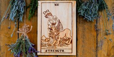 Strength Tarot Card Meaning: Upright, Reversed & In Love