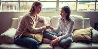 mom talking to daughter on couch