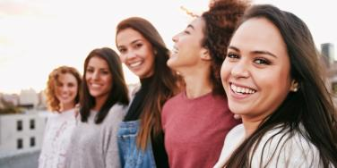 smiling group of five women