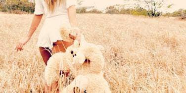 woman with stuffed animal