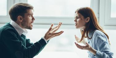man and woman in a heated argument