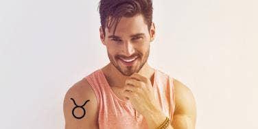 man with taurus tattoo