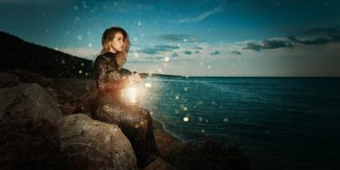 woman by the water at night