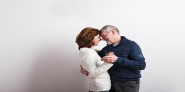 older happy couple dancing