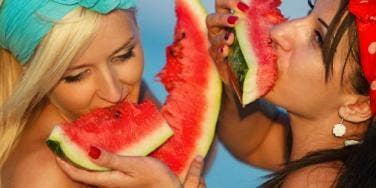 two women eating watermelon