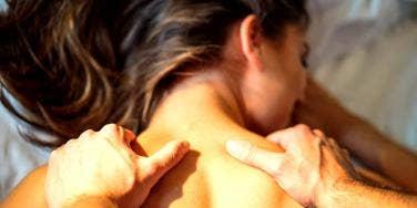man giving woman sexual massage
