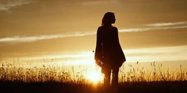 woman's silhouette at sunset