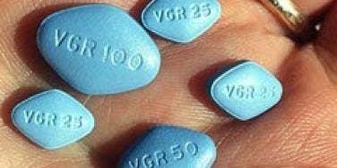 viagra in man's hand