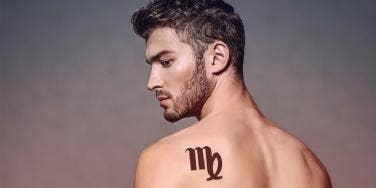 man with virgo tattoo on shoulder