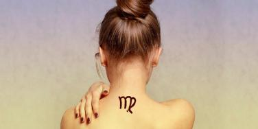 woman with virgo tattoo on her neck
