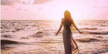 woman standing in front of ocean