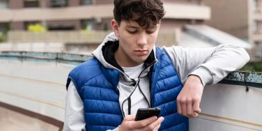 boy looking at iphone