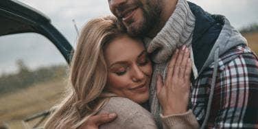 woman hugging man