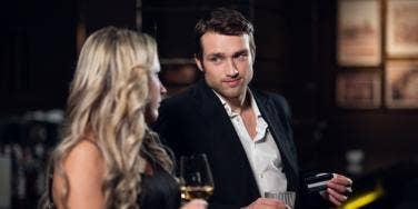 man and woman at bar