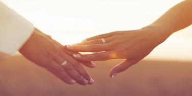 married hands touching