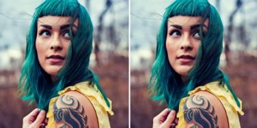 woman with green hair and bangs smiling