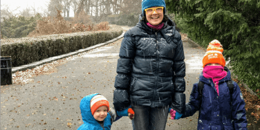 mom walking with her two young children on winter solstice