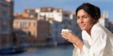 woman enjoying breakfast outdoors