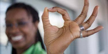 woman giving okay sign