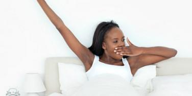 woman yawning in bed