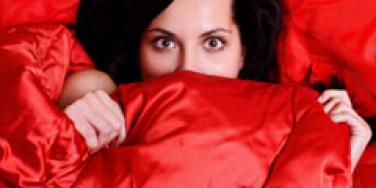 woman hiding in bed