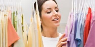woman picking out clothes in closet