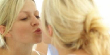 Woman kissing her mirror