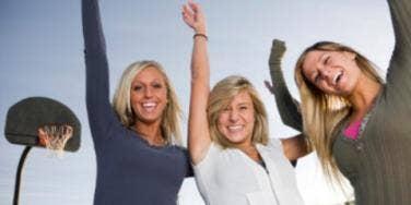 women cheering basketball