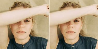woman with arm over her face