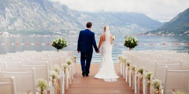 bride and groom at wedding with mountainous background