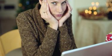 unhappy woman at laptop