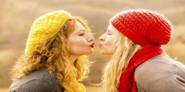 two women almost kissing