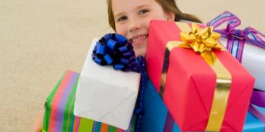 kid with presents