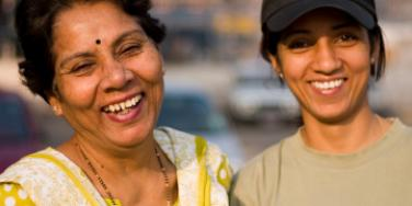 Indian mother and daughter smiling