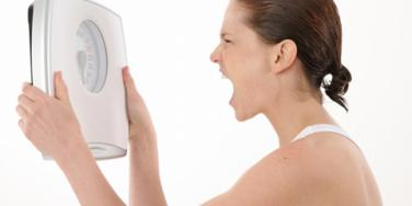 woman yelling at scale
