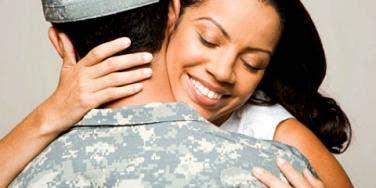 wife hugging military husband