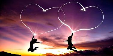 couple with hearts in the sky