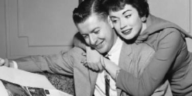 man woman cuddle vintage