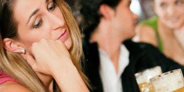 upset woman at bar
