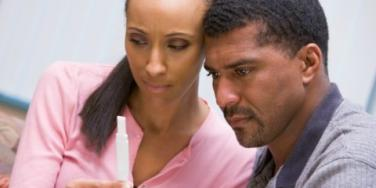 couple looking at pregnancy test