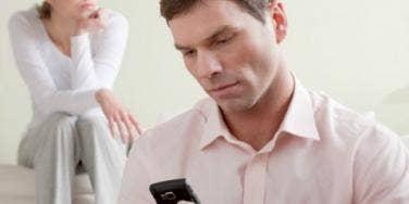 man reading through texts