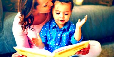 kid reading with mom