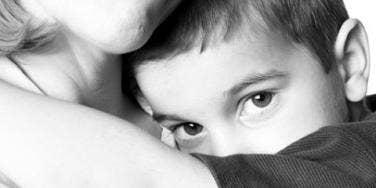 kid hugging woman